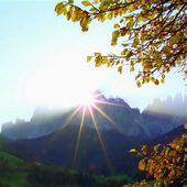 Morning sun in the mountains icon