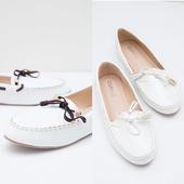 Women's flat shoes design icon